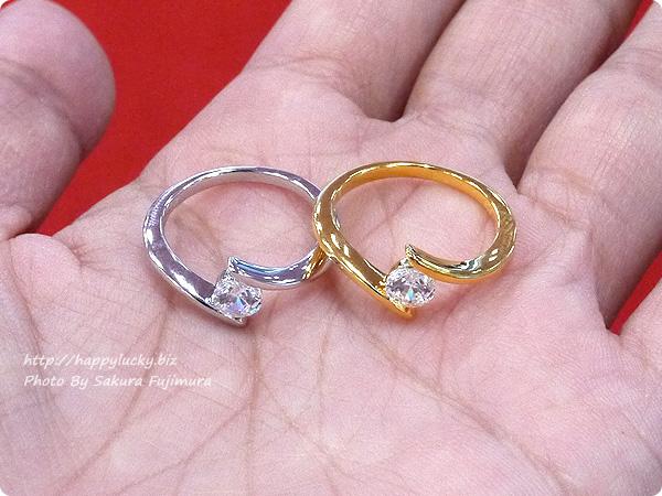 楽天市場JewelryCastle ネックレス・指輪 流線型が美しい 0.3カラット スワロフスキージルコニアデザイナーズリング SV925シルバーとゴールドの2色から選べる