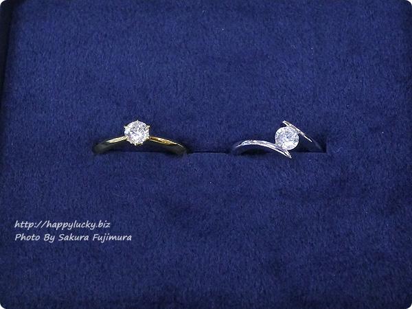 楽天市場JewelryCastle ネックレス・指輪 0.3カラット スワロフスキージルコニア一粒リングと流線型が美しい 0.3カラット スワロフスキージルコニアデザイナーズリング比較